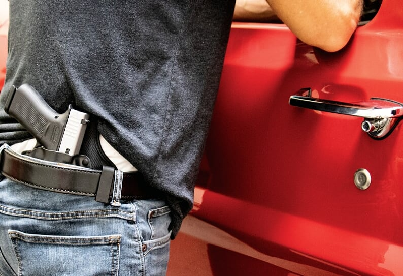 Guy with Gun in Holster Summer Carry