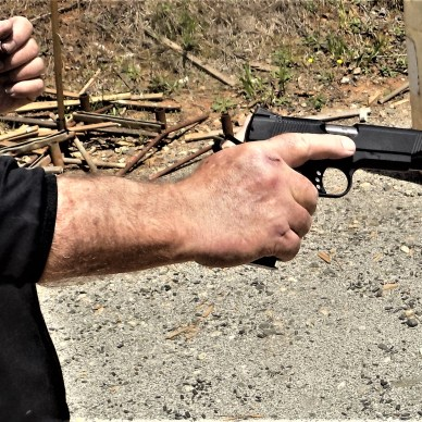 Man with firm grip on 1911 pistol