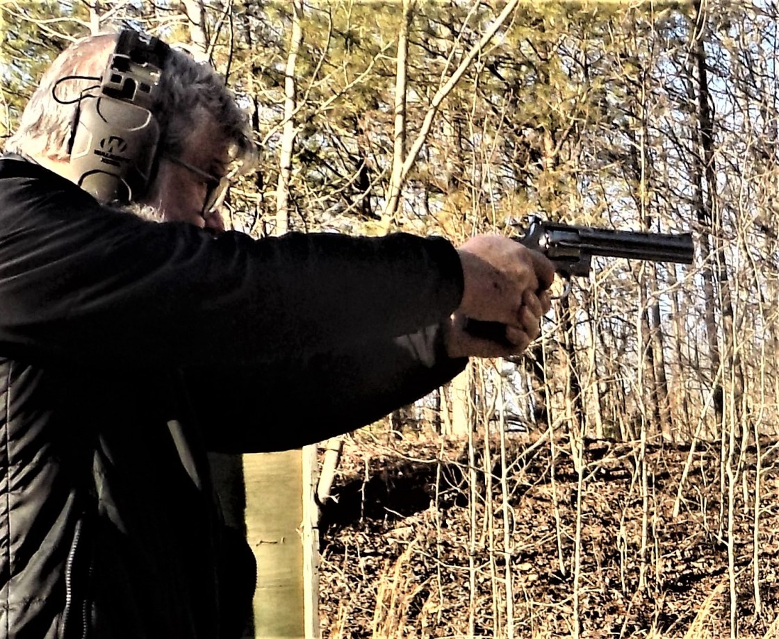 Man Shooting Colt Python Grail Guns