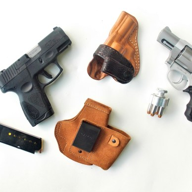 Different firearms and holsters