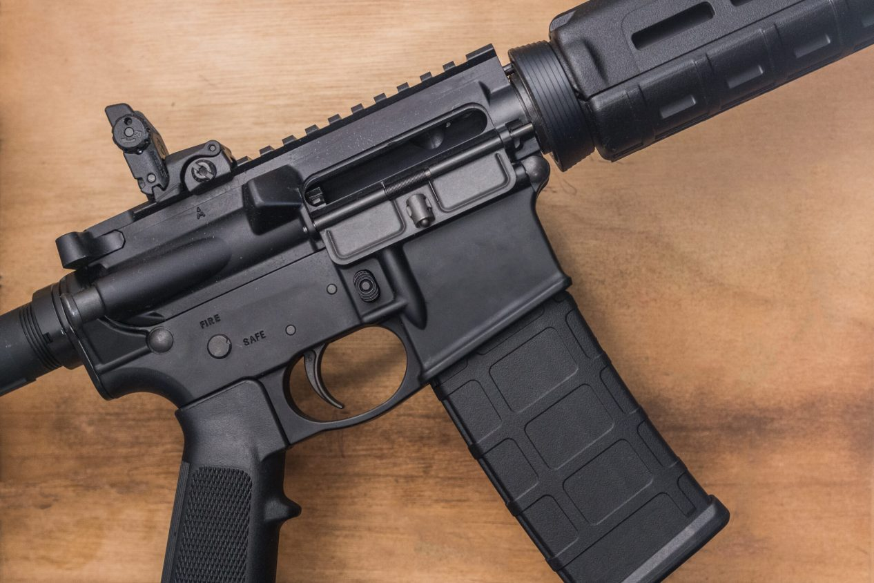 AR rifle with brown background