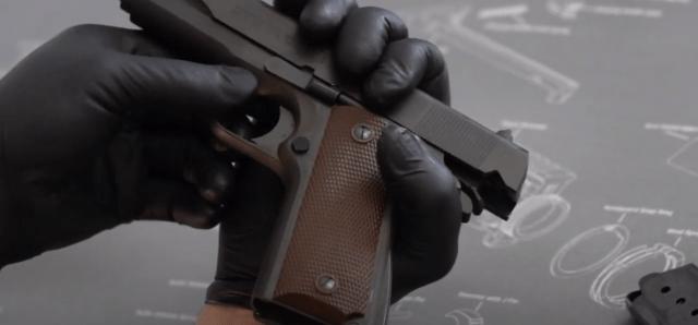 1911 pistol with slide pulled back
