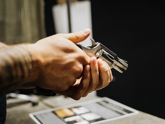 Hands holding a revolver