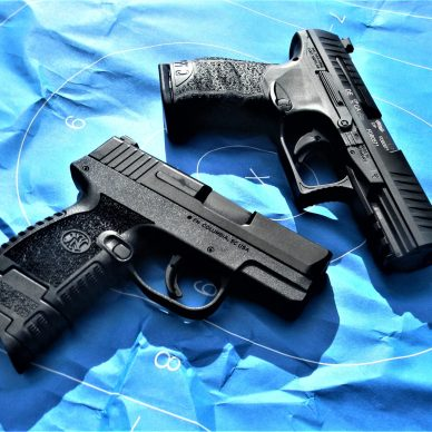 FN and Walther pistols on target