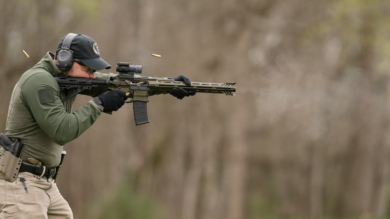 man shooting AR-15 rifle