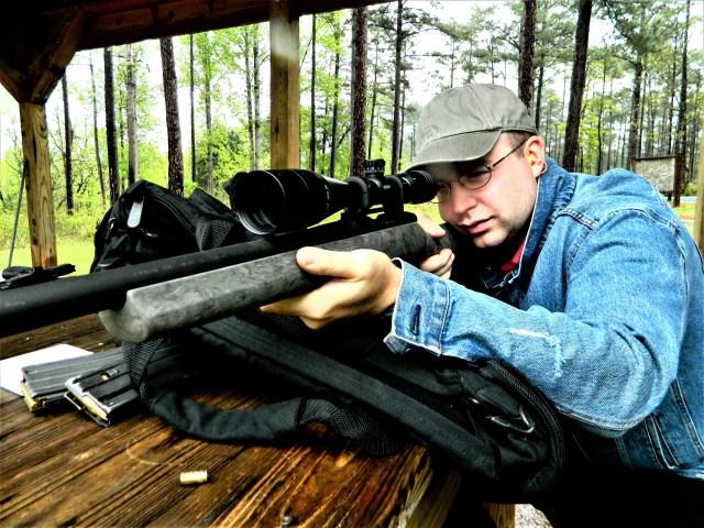 Man shooting rifle at range