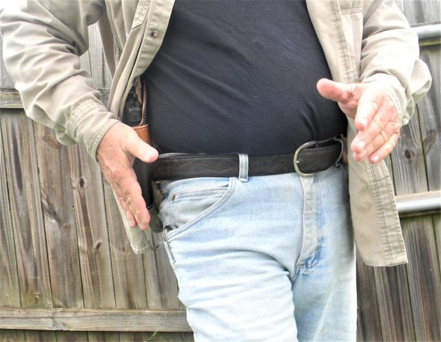 man practicing concealed carry draw stroke