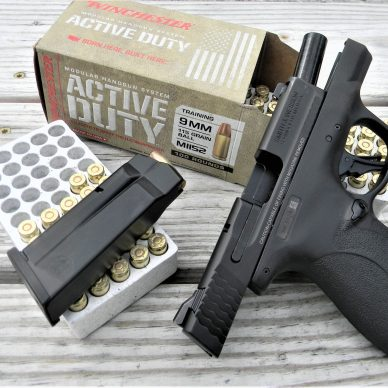 M&P plus pistol and magazine on ammo