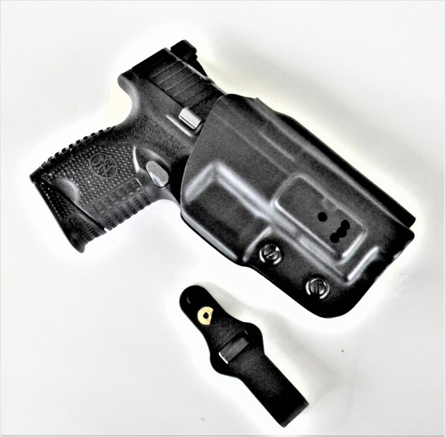 pistol in leather holster