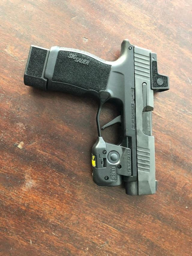 SIG P365XL with extended mag, weapon light and red dot sight