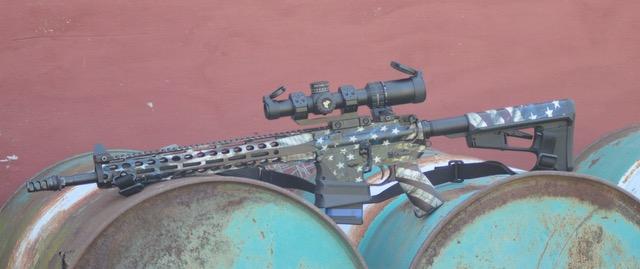 AR-15 rifle on barrels