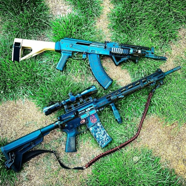 AR-15 and AK Rifles on Grass