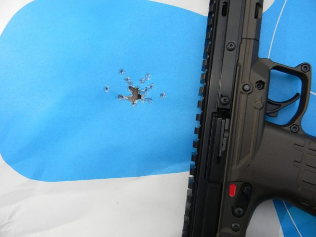 Kel-tec CP33 on target with small holes closely grouped
