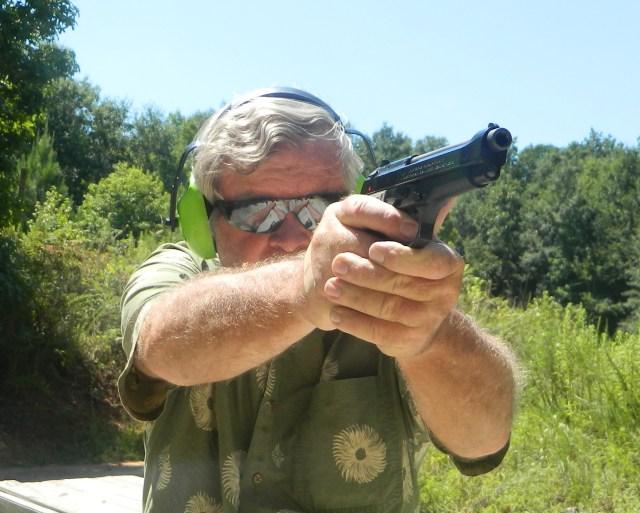 mans shooting beretta 92 pistol