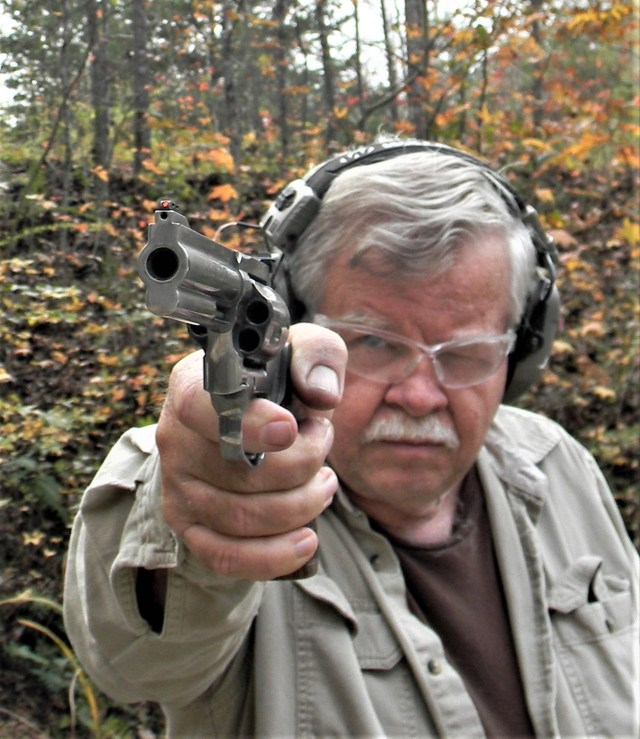 man pointing revolver
