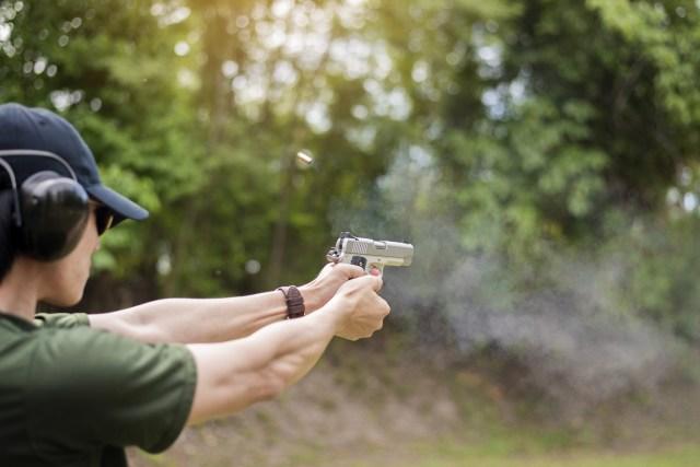 A man is practicing shoot gun recoil