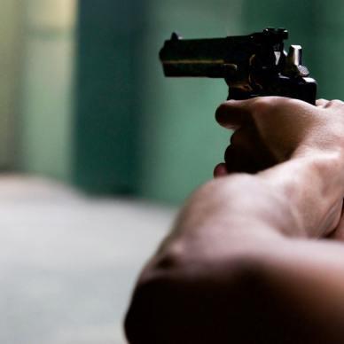 man shooting double action revolver