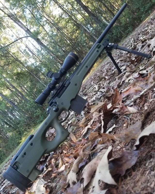 Rifle on woods floor