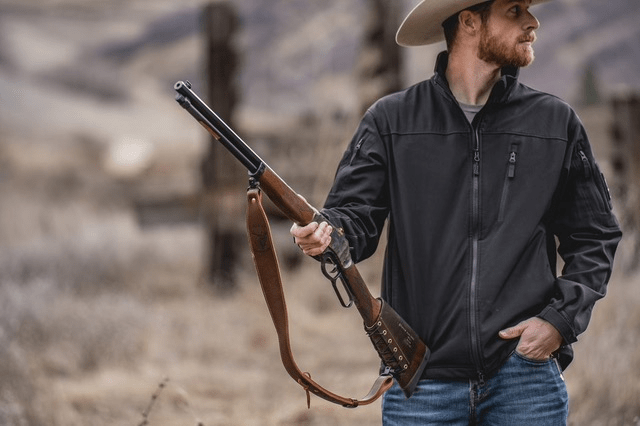 Man holding henry lever-action rifle
