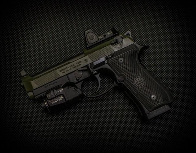 Beretta 92 series pistol with red dot sight