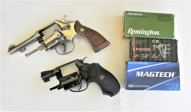 two revolvers and boxes of ammo