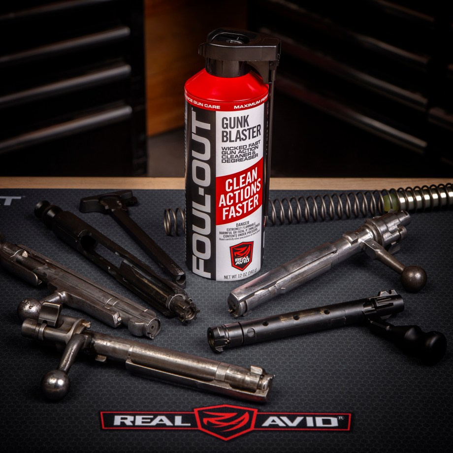 firearm bolts and gun cleaner spray on table