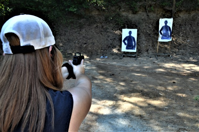 woman shooting on range