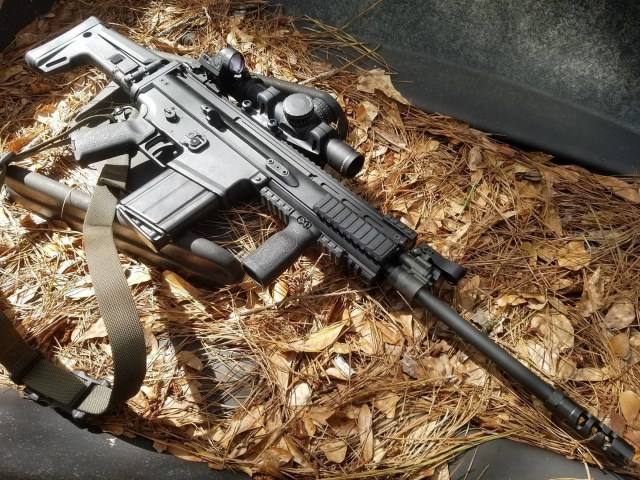 FN SCAR Rifle on Leaves