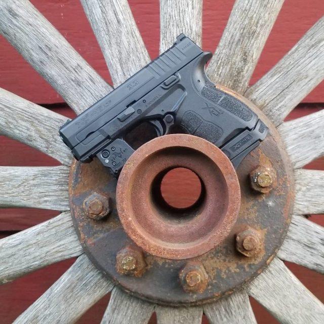 pistol on wooden wheel