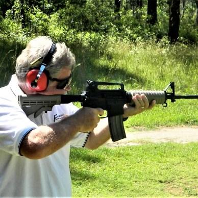 man shooting budget AR-15