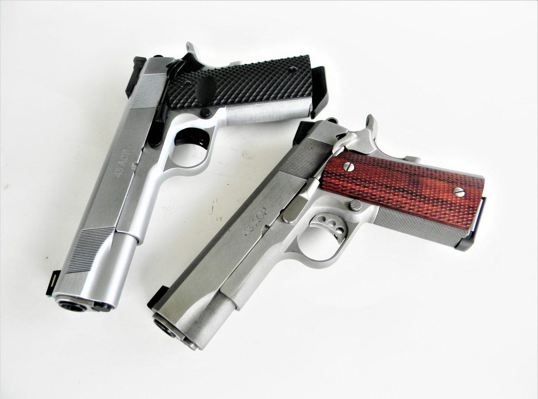 two high-end 1911 handguns