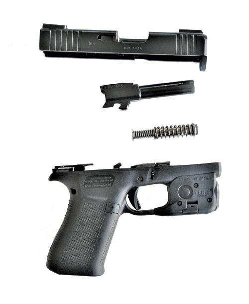 Field stripped Glock 43X pistol right profile