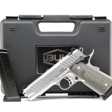 Magnum research 1911 from Bul in front of a black hard case and with a spare magazine