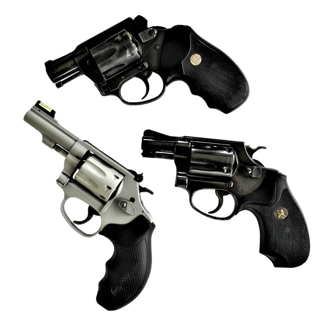 three snub nose revolvers chambered in different caliber to include .32 magnum, .38 special, and .22 LR