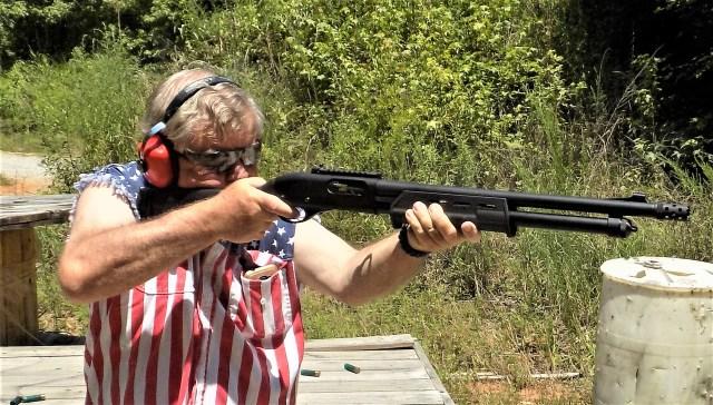 bob campbell at an outdoor range shooting a remington 870 pump-action shotgun