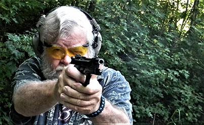 Bob Campbell aiming down the sights of the Girsan Regard Gen 4 pistol