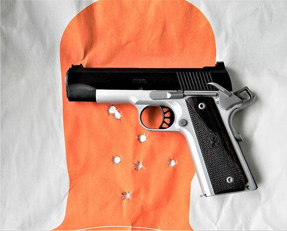Springfield Ronin Operator Commander left profile on an orange silhouette target