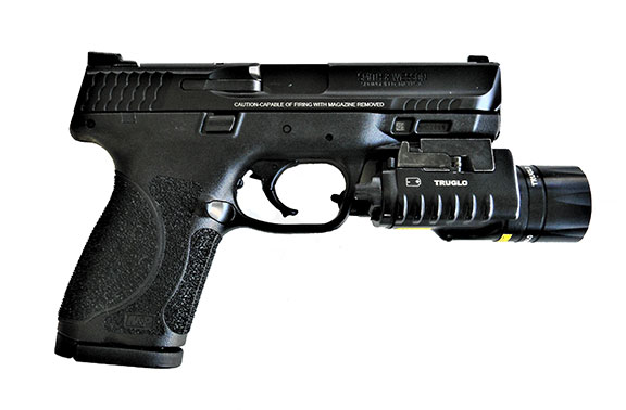 Smith and Wesson Military & Police 2.0 pistol right profile with a TruGlo combat light attached