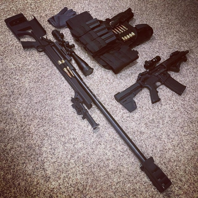 Bolt-action rifle with scope, AR pistol, and bulletproof vest