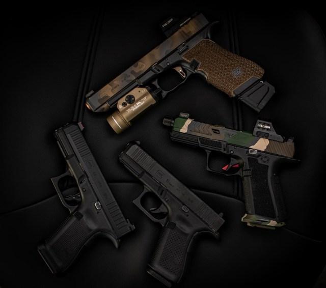 customized pistols on black background