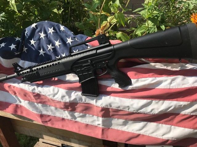 Rock Island AR shotgun on American flag