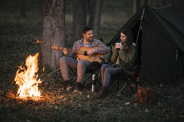 8 Fun Ideas to Spend Weekend Holidays With Your Partner- couple camping together