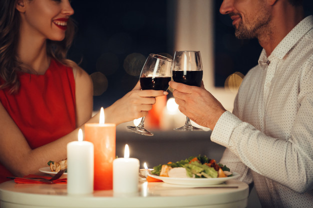 11 Wonderful Ways to Celebrate Valentine's Day in 2021-couple-lovers-having-romantic-dinner-home_