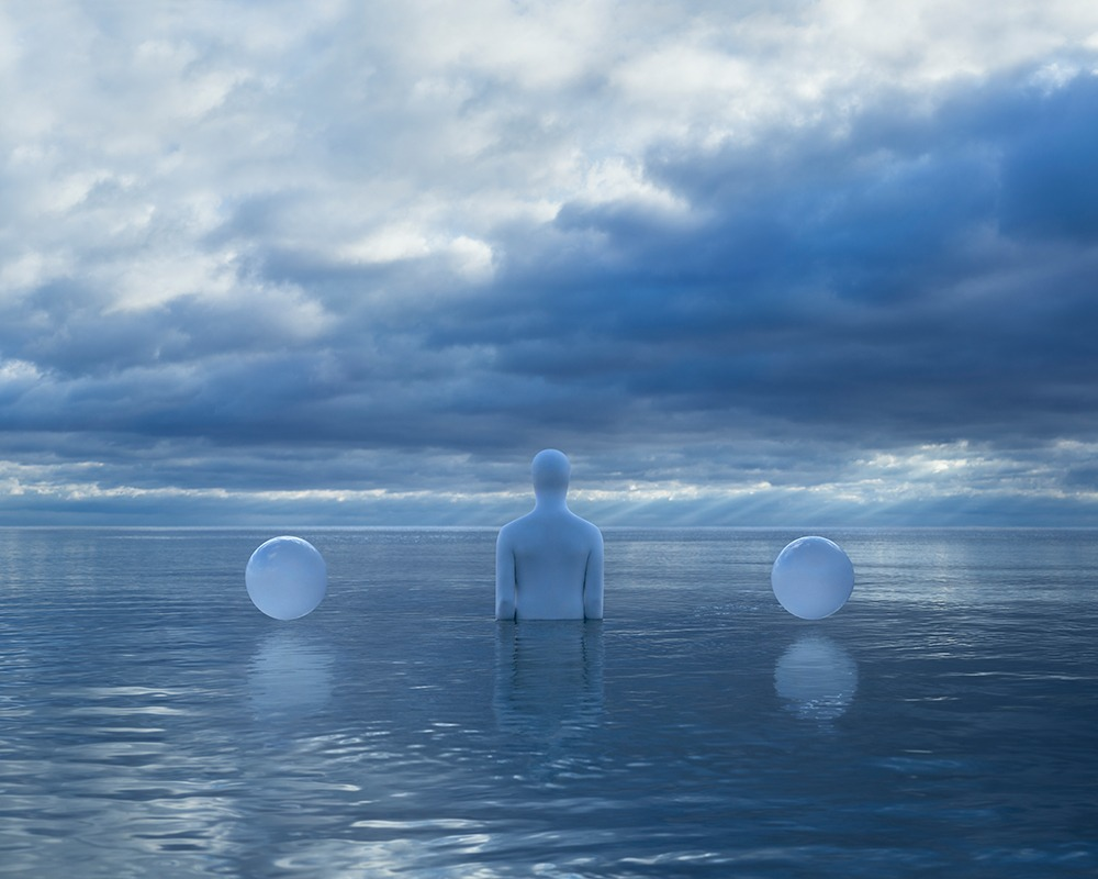 Person and two white balls in the water
