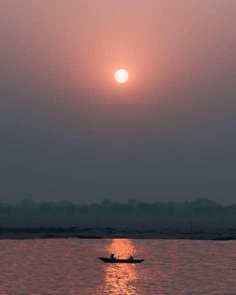James Tran canoe water sunset calming images