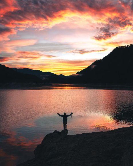 Christian Aran sky sunset guy mountain calming image