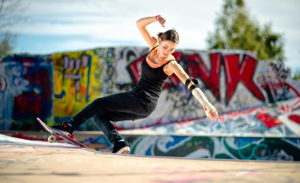 __The_girl_with_skateboard_performs_a_trick__swag_047316_