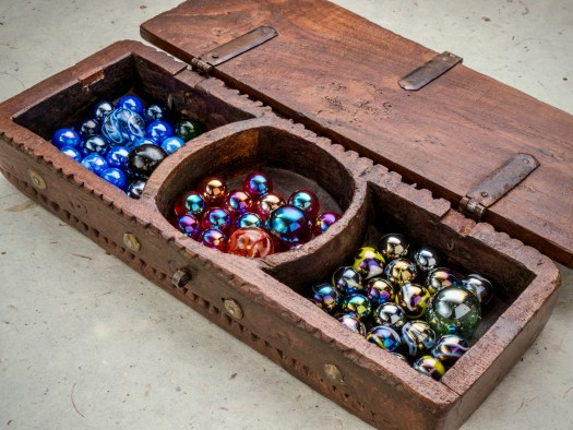 Indian wooden box with glass marbles
