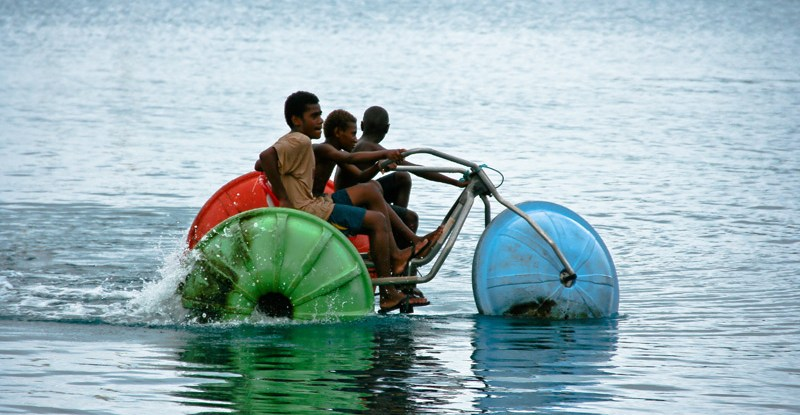 Children play in the water at Port Vila, Vanuatu. Rising sea levels as a result of climate change are a great concern for Pacific island nations.