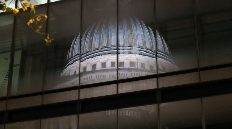 Dome of St Paul's reflected in the glass of One New Exchange